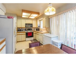 Photo 6: 9358 PRINCE CHARLES Boulevard in Surrey: Queen Mary Park Surrey House for sale : MLS®# R2417764