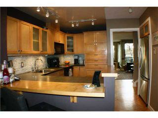 "Photo 2: 860 GREENCHAIN in Vancouver: False Creek Townhouse for sale in ""HEATHER POINT"" (Vancouver West)  : MLS®# V884740"