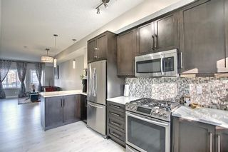 Photo 7: 442 Nolan Hill Boulevard NW in Calgary: Nolan Hill Row/Townhouse for sale : MLS®# A1073162