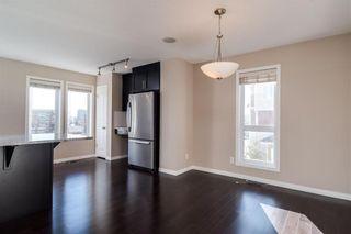 Photo 4: 1402 Auburn Bay Square SE in Calgary: Auburn Bay Row/Townhouse for sale : MLS®# A1103124