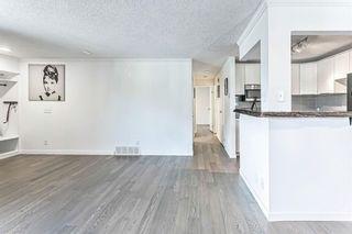 Photo 13: 15 Cedar Spring Gardens SW in Calgary: Cedarbrae Row/Townhouse for sale : MLS®# A1103133