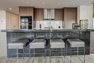 Photo 2: 501 128 Waterfront Court SW in Calgary: Chinatown Apartment for sale : MLS®# A1107113