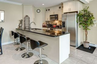 """Photo 5: 302 311 LAVAL Square in Coquitlam: Maillardville Townhouse for sale in """"HERITAGE ON THE SQUARE"""" : MLS®# R2097226"""