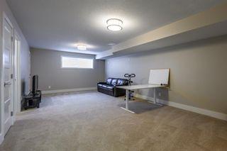 Photo 28: 524 Quarry Park Boulevard SE in Calgary: Douglasdale/Glen Row/Townhouse for sale : MLS®# A1084098