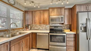 Photo 18: 184 Hidden Spring Close NW in Calgary: Hidden Valley Detached for sale : MLS®# A1141140