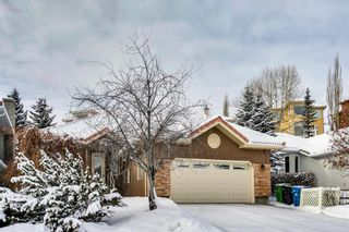 Photo 1: 222 SIGNATURE Way SW in Calgary: Signal Hill Detached for sale : MLS®# A1049165