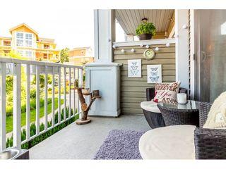 "Photo 19: 211 6480 194 Street in Surrey: Clayton Condo for sale in ""Waterstone"" (Cloverdale)  : MLS®# R2281179"