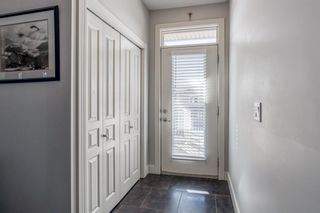 Photo 4: 6 140 ROCKYLEDGE View NW in Calgary: Rocky Ridge Row/Townhouse for sale : MLS®# A1079853