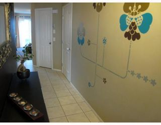 Photo 2: 153 EVERSYDE Common SW in Calgary: Evergreen Townhouse for sale : MLS®# C3386146