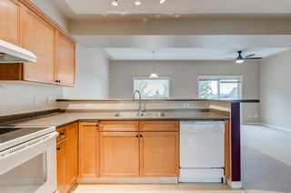 Photo 7: 97 Country Hills Gardens NW in Calgary: Country Hills Row/Townhouse for sale : MLS®# A1149048