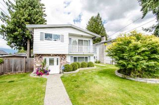 Photo 1: 971 REGAN Avenue in Coquitlam: Central Coquitlam 1/2 Duplex for sale : MLS®# R2397027