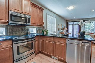 Photo 9: 7 ELYSIAN Crescent SW in Calgary: Springbank Hill Semi Detached for sale : MLS®# A1104538