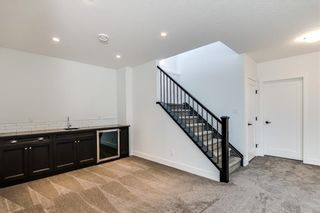 Photo 25: 152 ROCK LAKE View NW in Calgary: Rocky Ridge Detached for sale : MLS®# A1062711