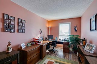 Photo 24: 39 185 Woodridge Drive SW in Calgary: Woodlands Row/Townhouse for sale : MLS®# A1069309