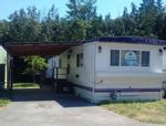 """Main Photo: 4 4200 DEWDNEY TRUNK Road in Coquitlam: Ranch Park Manufactured Home for sale in """"HIDEWAY PARK"""" : MLS®# R2282330"""