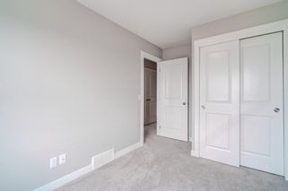 Photo 27: 907 Jumping Pound Common: Cochrane Row/Townhouse for sale : MLS®# A1132952