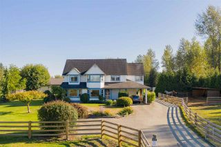 Photo 1: 25350 64 AVENUE in Langley: County Line Glen Valley House for sale : MLS®# R2400914