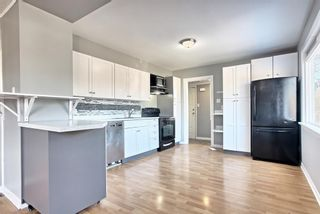 Photo 5: 7943 48 Avenue NW in Calgary: Bowness Detached for sale : MLS®# A1096332