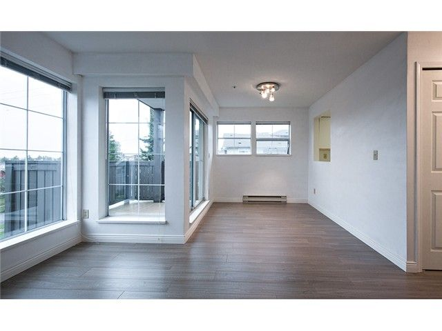 """Main Photo: 301 3308 VANNESS Avenue in Vancouver: Collingwood VE Condo for sale in """"VANNESS GARDENS"""" (Vancouver East)  : MLS®# V1087478"""