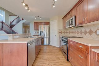 Photo 10: 144 Tuscany Meadows Heath NW in Calgary: Tuscany Detached for sale : MLS®# A1030703