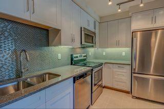 Photo 4: 106 25 Auburn Meadows Avenue SE in Calgary: Auburn Bay Apartment for sale : MLS®# A1124019