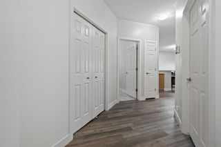 Photo 2: 103 4718 Stanley Road SW in Calgary: Elboya Apartment for sale : MLS®# A1103796