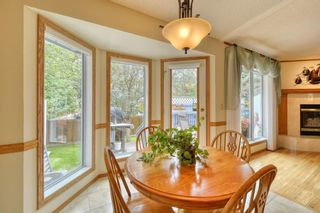 Photo 17: 20A Woodmeadow Close SW in Calgary: Woodlands Row/Townhouse for sale : MLS®# A1127050