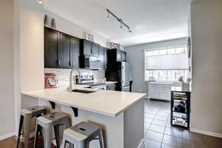 Photo 14: 1103 125 Panatella Way NW in Calgary: Panorama Hills Row/Townhouse for sale : MLS®# A1143179