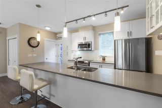 "Photo 7: 104 218 BEGIN Street in Coquitlam: Maillardville Townhouse for sale in ""BEGIN SQUARE"" : MLS®# R2561894"