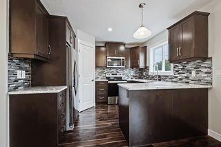 Photo 3: 105 4 Avenue SE: High River Detached for sale : MLS®# A1150749