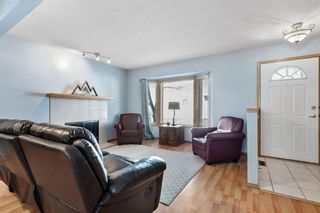 Photo 2: 144 Riverglen Park SE in Calgary: Riverbend Row/Townhouse for sale : MLS®# A1083085