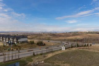 Photo 38: 2407 15 SUNSET Square: Cochrane Apartment for sale : MLS®# A1072593