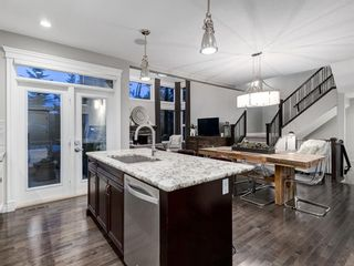 Photo 10: 86 ASCOT Crescent SW in Calgary: Aspen Woods Detached for sale : MLS®# A1128305