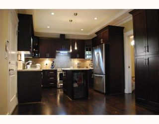 """Photo 2: 1950 E 64TH Avenue in Vancouver: Fraserview VE House for sale in """"FRASERVIEW"""" (Vancouver East)  : MLS®# V785070"""