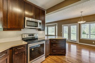 Photo 8: 45 PROMINENCE Park SW in Calgary: Patterson Semi Detached for sale : MLS®# C4249195