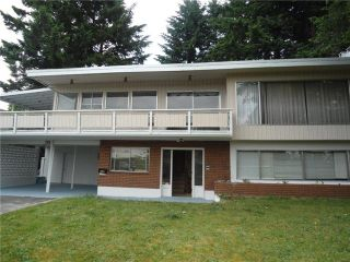 Photo 2: 703 PEMBROKE Avenue in Coquitlam: Coquitlam West House for sale : MLS®# V1126678