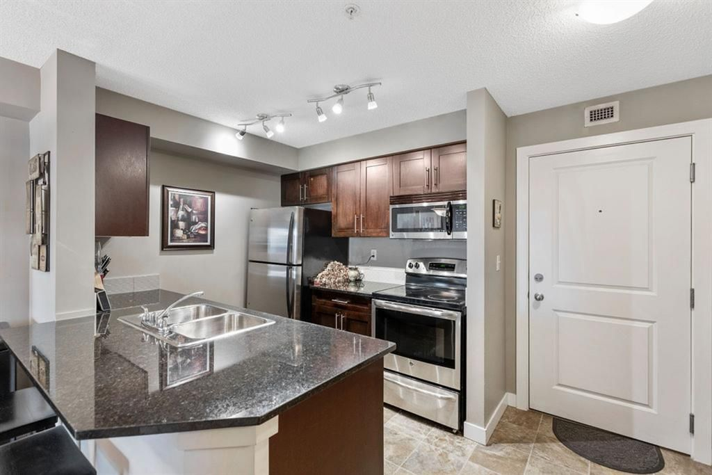 Main Photo: 3306 403 Mackenzie Way SW: Airdrie Apartment for sale : MLS®# A1153505