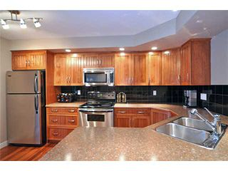 Photo 3: 54 YPRES Green SW in CALGARY: Garrison Woods Residential Attached for sale (Calgary)  : MLS®# C3489749