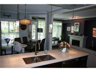 """Photo 7: 105 3600 WINDCREST Drive in North Vancouver: Roche Point Townhouse for sale in """"RAVEN WOODS"""" : MLS®# V1101013"""