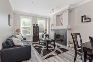 """Photo 1: 21145 80 Avenue in Langley: Willoughby Heights Condo for sale in """"YORKVILLE"""" : MLS®# R2597034"""