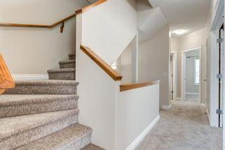 Photo 15: 4111 Garrison Boulevard SW in Calgary: Garrison Woods Row/Townhouse for sale : MLS®# A1108505