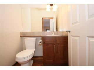 Photo 13: 103 WEST POINTE Court: Cochrane House for sale : MLS®# C4042878