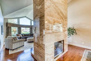 Photo 6: 555 Coach Light Bay SW in Calgary: Coach Hill Detached for sale : MLS®# A1144688