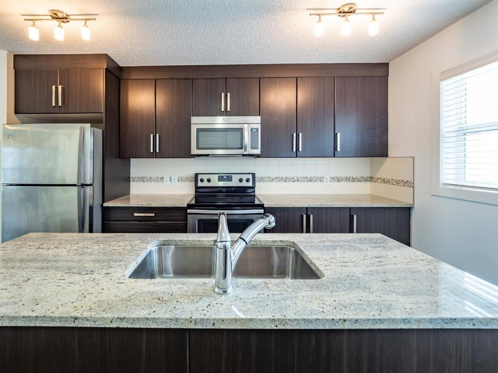 Photo 7: Photos: 544 Mckenzie Towne Close SE in Calgary: McKenzie Towne Row/Townhouse for sale : MLS®# A1128660