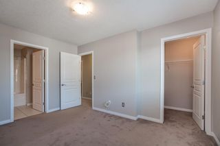 Photo 12: 8 Everridge Gardens SW in Calgary: Evergreen Row/Townhouse for sale : MLS®# A1041120