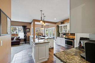 Photo 11: 61 Strathridge Crescent SW in Calgary: Strathcona Park Detached for sale : MLS®# A1152983