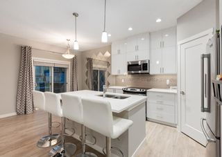 Photo 4: 604 428 NOLAN HILL Drive NW in Calgary: Nolan Hill Row/Townhouse for sale : MLS®# A1150776