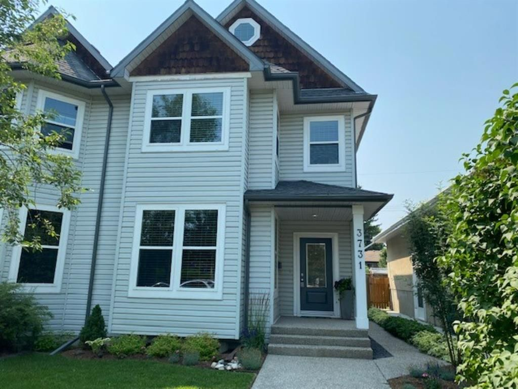 Main Photo: 3731 42 Street SW in Calgary: Glenbrook Semi Detached for sale : MLS®# A1132600