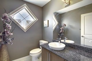 Photo 16: 47 WEST SPRINGS Lane SW in Calgary: West Springs Row/Townhouse for sale : MLS®# A1039919