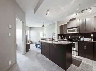 Photo 2: 1301 5605 Henwood Street SW in Calgary: Garrison Green Apartment for sale : MLS®# A1112799